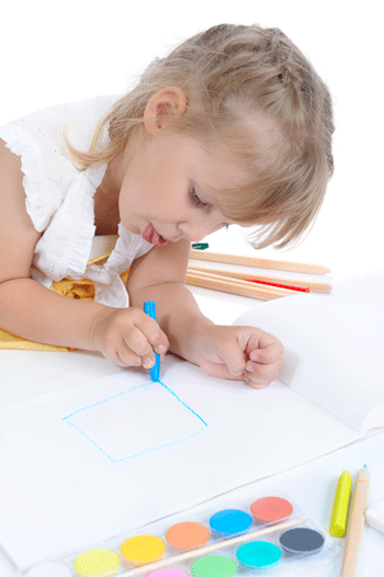 Girl drawing with blue crayon